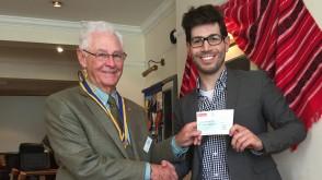 Harrow's Rotary Club President Colin MacDougall provides a cheque to Radio Harrow's Trustee Matt Blank