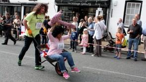 Jon Hart and Biba Hunjan from Radio Harrow take part in the wheelbarrow race of 2014